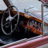 Old car Jaguar. Retro car style dashboard Jaguar Stock Images