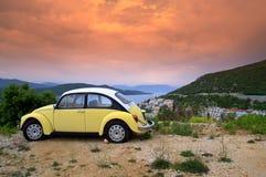 Retro car at sunrise coast stock photography