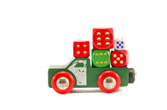 Retro car toy and colorful dice Stock Photography