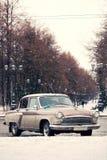 Retro  car under snowfall Stock Photography