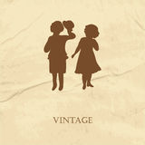 Retro card with silhouette of two cute babies on the grunge paper background Royalty Free Stock Photos
