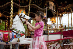 Retro carousel. Little girl on 100 years old carousel in Annecy , France royalty free stock photo