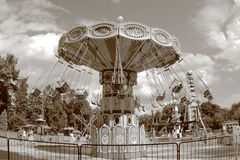 Retro carousel at amusement park. Retro carousel in an empty amusement park in late summer Stock Image