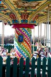 Retro carousel in empty closed fairground. Close up crop Royalty Free Stock Image