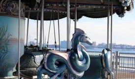 Retro carousel ride old school ride for kids at Detroit riverside walk Royalty Free Stock Photos
