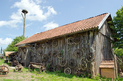 Retro carriage wheel barn house bench stork nest Royalty Free Stock Photography