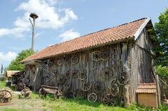 Retro carriage wheel barn house bench stork nest Royalty Free Stock Photography
