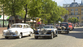 Retro cars Berlina Coupe, Zaporozhets and BMW on rally Royalty Free Stock Photo