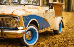 Retro cars in a fall forest custom truck creative idea with blue color artificial rust and wooden luggage stock photography