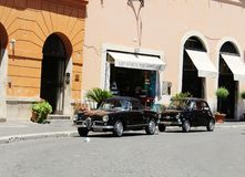 Retro cars in square in Roma royalty free stock photo