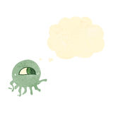 Retro cartoon alien jellyfish with thought bubble Royalty Free Stock Images