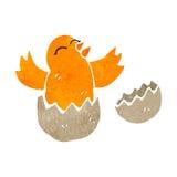 Retro cartoon bird hatching from egg Stock Photos
