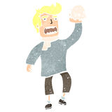 Retro cartoon blond actor holding skull Royalty Free Stock Image