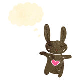 Retro cartoon bunny rabbit with love heart Stock Photo