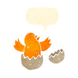 retro cartoon chick hatching from egg Stock Photography