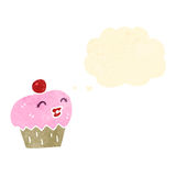 Retro cartoon cupcake Royalty Free Stock Photos