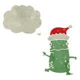 retro cartoon dancing frog with chirstmas hat Royalty Free Stock Images