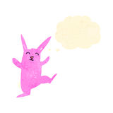 Retro cartoon dancing pink rabbit Stock Photos