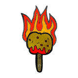 Retro cartoon flaming toffee apple Royalty Free Stock Photo