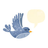 Retro cartoon flying bird with speech bubble Royalty Free Stock Image