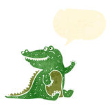 retro cartoon friendly crocodile waving Stock Images