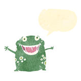 retro cartoon frog with speech bubble Stock Images