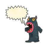 Retro cartoon hairy monster with speech bubble Royalty Free Stock Images
