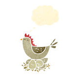 Retro cartoon hen on nest of eggs Royalty Free Stock Image