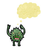 Retro cartoon little imp with thought bubble Stock Image