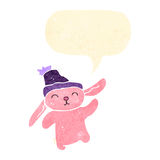 Retro cartoon little pink rabbit with speech bubble Royalty Free Stock Images