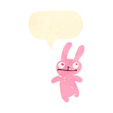 Retro cartoon little pink rabbit with speech bubble Royalty Free Stock Photography