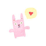 Retro cartoon pink rabbit Stock Photography