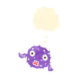 Retro cartoon puffer fish with thought bubble Royalty Free Stock Photography
