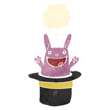 Retro cartoon rabbit in hat trick Royalty Free Stock Photos