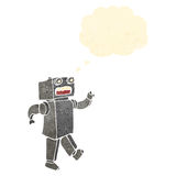 Retro cartoon robot with thought bubble Stock Images