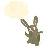 retro cartoon spooky dancing rabbit with thought bubble Royalty Free Stock Photos