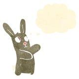 Retro cartoon spooky dancing rabbit with thought bubble Stock Photos