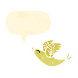 Retro cartoon tweeting yellow bird Stock Images