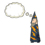 Retro cartoon wizard with thought bubble Stock Photography