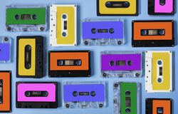 Retro cassette tape collection on blue background. Retro cassette tape collection on blue background, top view royalty free stock photography