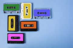 Retro cassette tape collection on blue background. stock photo
