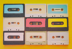Retro cassette tape collection over yellow wooden table. top view. copy space Stock Photo