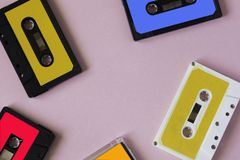 Retro cassette tape collection on pink background, top view. cop stock photos