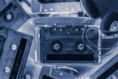 Retro cassette tape with headphones and walkman Royalty Free Stock Photo