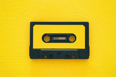 Retro cassette tape over yellow wooden table. top view. Copy space royalty free stock images