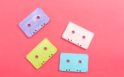 Retro cassette tape. On a pink paper background stock photography