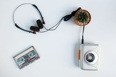 Retro cassette tape and Portable tape player with radio on white floor royalty free stock photo
