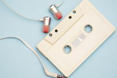 Retro cassette from tape recorder with tape and records of the 80s and 90s stock photography