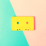 Retro cassette tapes on bright background. Retro cassette tapes on a bright duotone background stock image
