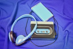 Retro cassette walkman on the blue fabric background Stock Photography